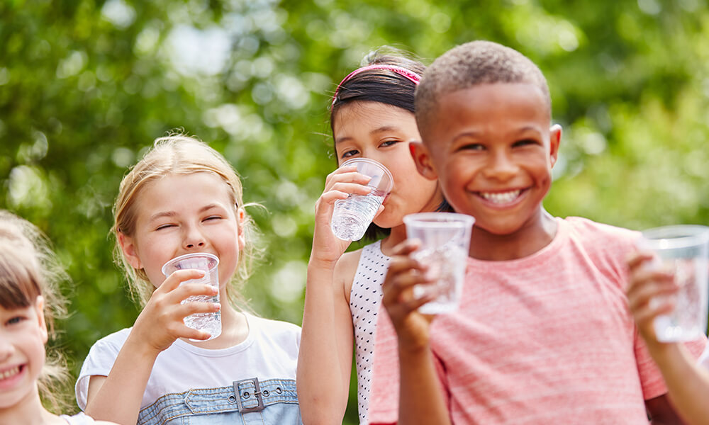 group of children who love to drink water together