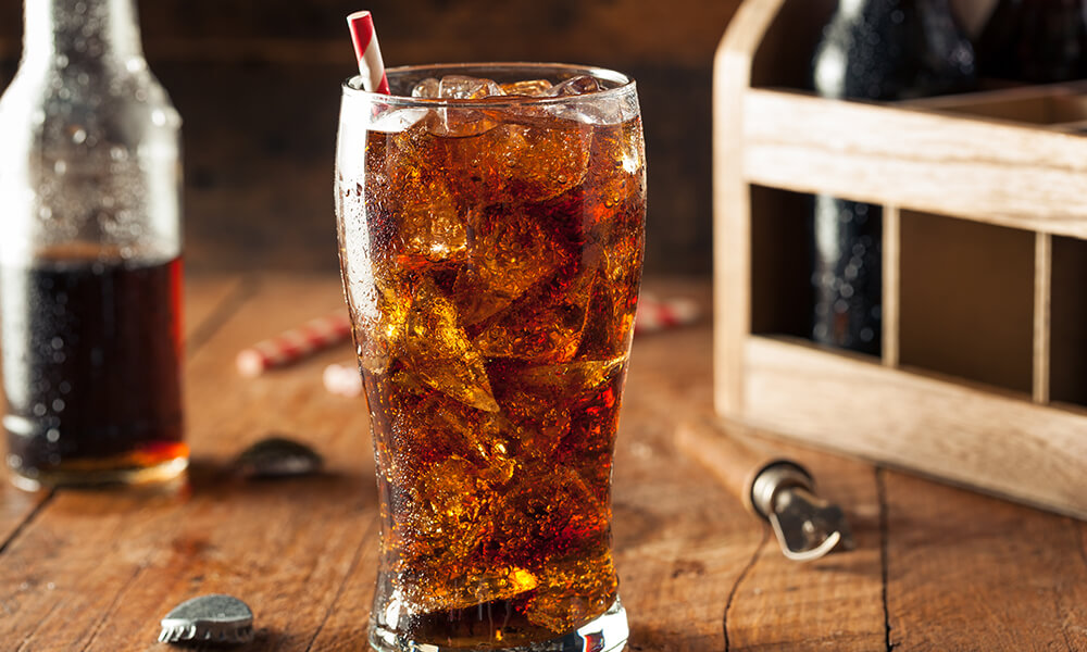 cup of soda with red straw on a wooden table