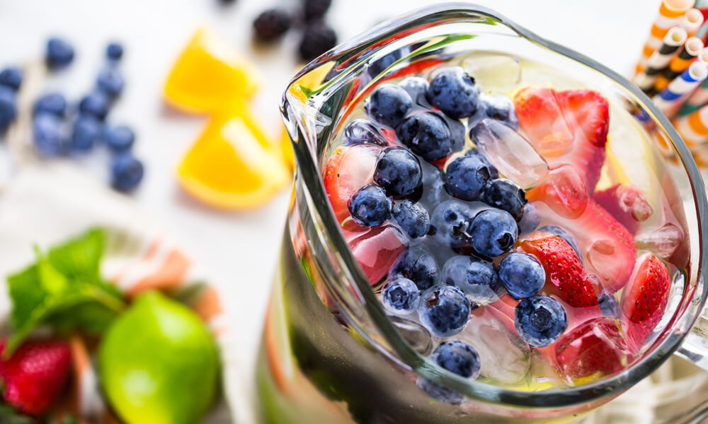 a pitcher filled with fruit infused water