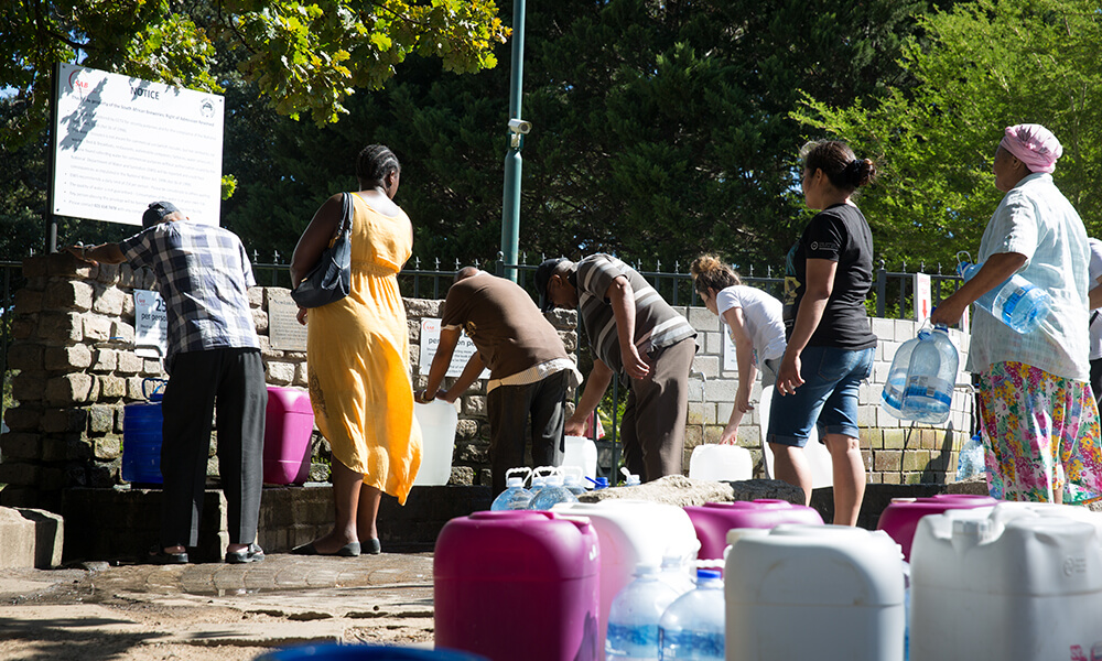 members of the Cape Town community filling their water bottles