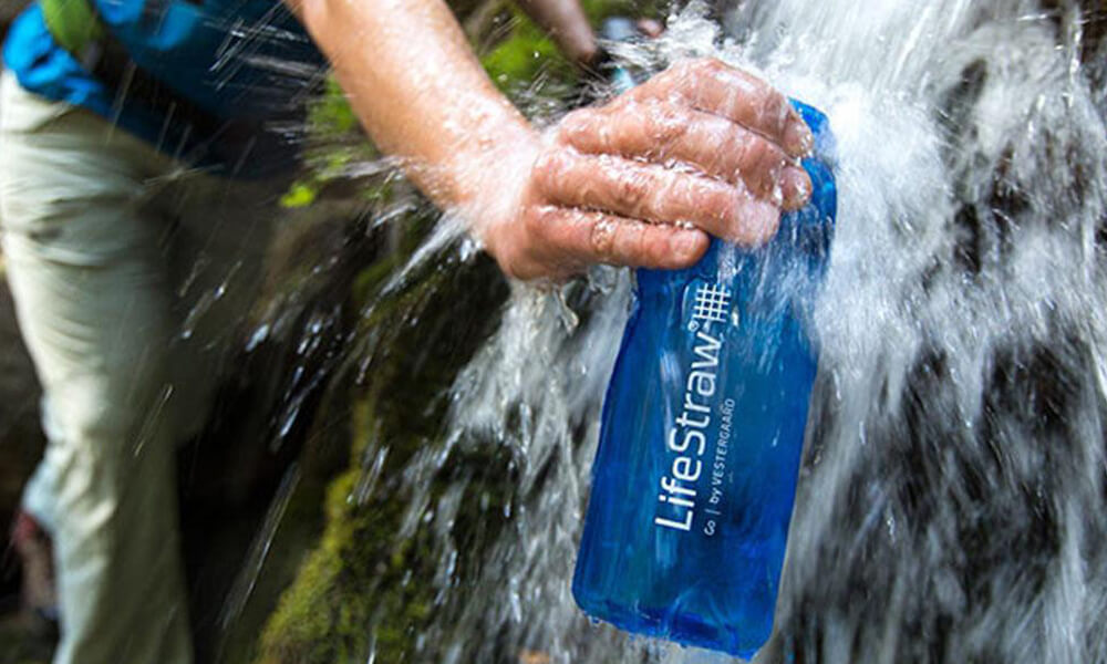 a lifestraw bottle being filled with water